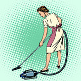 Woman vacuuming the room housewife housework. Comfort retro style pop art. Also the theme of the hotels and hospitality service Stock Images