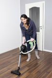 Woman vacuums the flat Stock Image