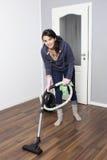 Woman vacuums the flat Stock Image