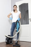 Woman vacuums the flat Royalty Free Stock Images