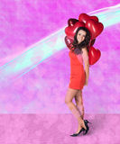 Woman with valentine baloons Stock Photography