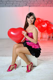 Woman on Valentine's Day with red balloons Royalty Free Stock Image