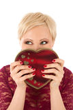 Woman with valentine's gift and funny look Stock Photography