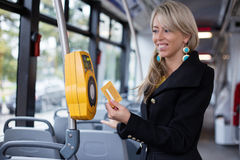 Woman validating electronic ticket in public transport Royalty Free Stock Photography