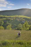 Woman in Valley With Sunbeams Royalty Free Stock Photo