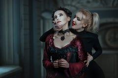 Woman vampire bites. Stock Images