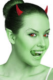 Woman with vampire fangs. Beautiful woman with vampire fangs and horns isolated on white Royalty Free Stock Photo