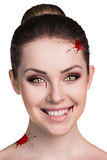Woman with vampire fangs Stock Photos