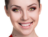 Woman with vampire fangs Stock Photo