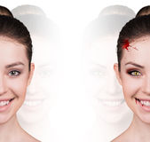 Woman with vampire fangs. Beautiful woman with vampire fangs isolated on white Stock Photography