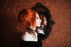 Charming girl with red hair Royalty Free Stock Photos