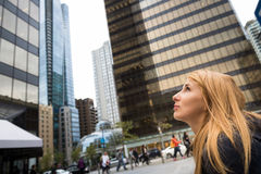 Woman in Vancouver. A woman looking up in the center of Vancouver, Canada stock images