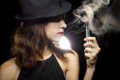 Woman Vaping E-Cigarette Stock Photo