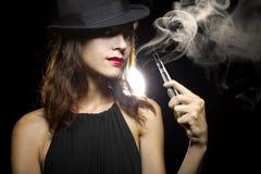 Woman Vaping E-Cigarette Stock Images