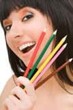 Woman with varicolored pencils Stock Image