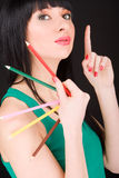Woman with varicolored pencils Stock Photography