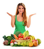 Woman with variety of fresh vegetables and fruits stock image