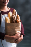 Woman with various bread Stock Photos
