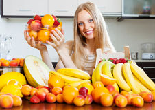 Woman with various fruits Royalty Free Stock Image
