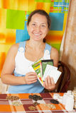 Woman with  various seeds Stock Images