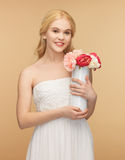 Woman with vase of flowers Stock Photo