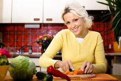 Woman with vegetable Stock Images