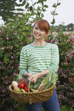 Woman With Vegetable Basket Outdoors Stock Photography