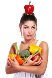 Woman and vegetables Stock Image