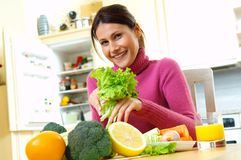 Woman with vegetables. Yong woman with fresh vegetables Stock Image
