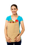 Woman With Vegetables Bag Over White Background Royalty Free Stock Photography