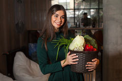 Woman and vegetables in basket Royalty Free Stock Image