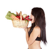 Woman vegetables bite Stock Images