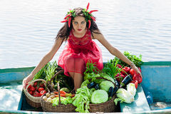 Woman with vegetables Stock Images