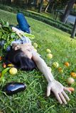 Woman with vegetables extending her hand. In a park Stock Images