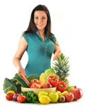 Woman with vegetables and fruits isolated on white Royalty Free Stock Image