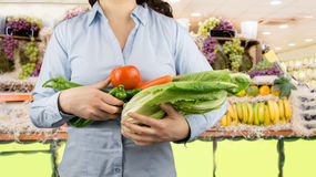 Woman with vegetables on the greengrocer Royalty Free Stock Images