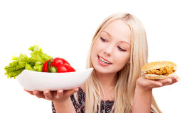 Woman with vegetables and hamburger Stock Image