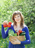 Woman with vegetables harvest in garden Royalty Free Stock Photo