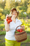 Woman with vegetables harvest Stock Photos