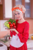 Woman with vegetables in kitchen Royalty Free Stock Photos