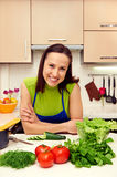 Woman with vegetables in kitchen Stock Photography