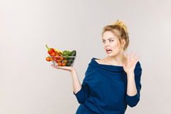 Woman with vegetables, negative face expression Stock Photos