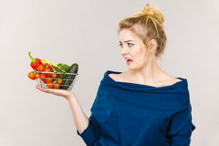 Woman with vegetables, negative face expression Stock Photo