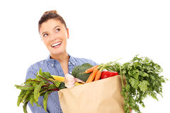 Woman and vegetables Royalty Free Stock Photos