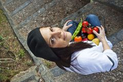 Woman with vegetables. In a stairs Royalty Free Stock Photos