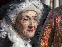 Woman with a Veil. Venice,Italy- February 18, 2012: Portrait of a mature medieval woman with a black veil over her face during the Venice Carnival Royalty Free Stock Photography