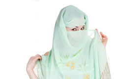 Woman with a veil. Young woman with a veil over her face smiling. Isolated on white background Stock Photos