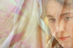 Woman  veil. Young woman with veil in deep thought for postcard Royalty Free Stock Images