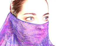 Woman with veil. High key portrait of a woman with a violet veil. Free space for copy royalty free stock photography