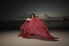 Woman with a veil on the beach Royalty Free Stock Photos